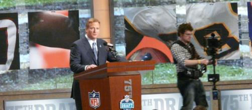 NFL Commissioner Roger Goodell at the podium for the annual NFL Draft. [Image via Flickr/Wikimedia Commons]