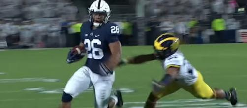 Penn State running back Saquon Barkley is expected to be amongst the top picks in the 2018 NFL Draft. [Image via ESPN/YouTube]