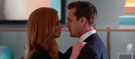Suits season 7 Donna and Harvey kiss {Image via Instagram/suits_usa}