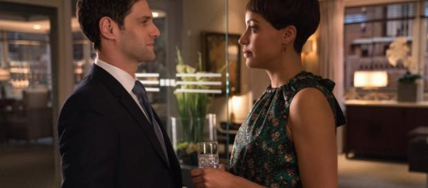 A pregnant Lucca chats with ex-lover at her work party.- [ Image via Twitter / The Good Fight]