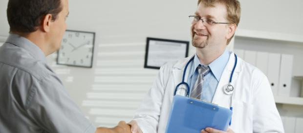 Doctor greeting patient   Medical office - middle-aged male …   Flickr - flickr.com