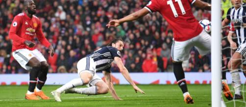 West Brom's Jay Rodriguez scores the winner at Old Trafford, handing Man City the title in the process. Credit: Laurence Griffiths/Getty Images