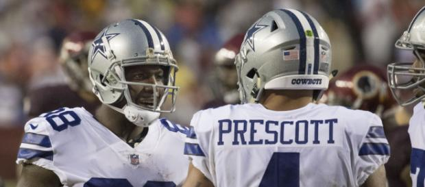 Dez Bryant and Dak Prescott talking during a game against the Redkins. - [Image via Keith Allison / Wikimedia Commons]