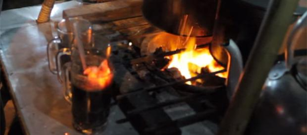 Charcoal coffee has been a novelty in Indonesia for the past 55 years. [Image Source: Hazmi Srondol Channel/YouTube]