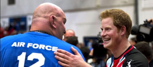 Prince Harry greets an airman during an exhibition volleyball match between U.S. and U.K. (Image credit - Tyler L. Main, Wikimedia Commons)