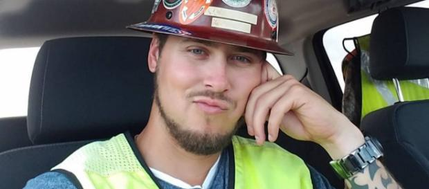 Jeremy Calvert poses in a hard hat. [Photo via Instagram]