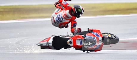 TOPSHOT - Ducati Team's Spanish rider Jorge Lorenzo falls from his ... - gettyimages.com