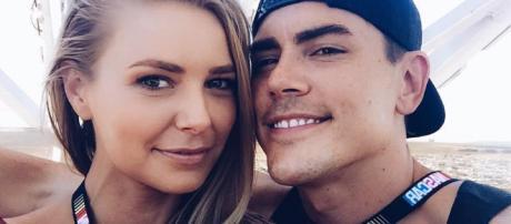 Ariana Madix and Tom Sandoval take a selfie at a NASCAR race. [Photo via Instagram]