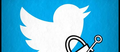 Twitter logo and lock with key - Esther Vargas via Flickr