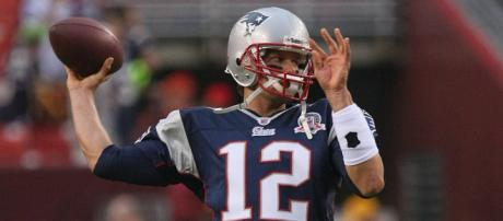Tom Brady warms up. By Keith Allison/Flickr