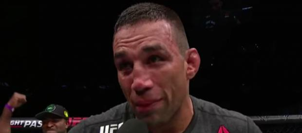 Fabricio Werdum talks inside the Octagon following his win at UFC Fight Night 121. [image source: UFC - Ultimate Fighting Championship/YouTube]