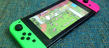 Nintendo Switch with neon green and pink/Joy-Cons via Flickr