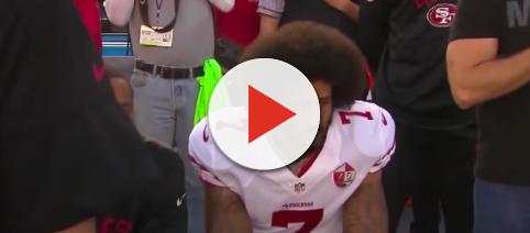 Colin Kaepernick started a movement when deciding to kneel during the national anthem. - [Image source: CBS Evening News / YouTube screenshot]