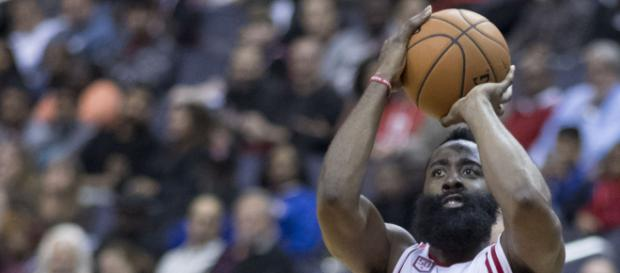This year's most likely MVP winner, James Harden, shooting over a Wizards defender. Image via Keith Allison/Wikimedia Commons.