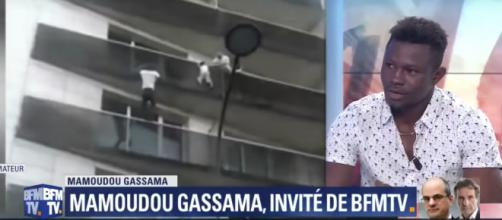Mr Gassama quickly climbed up, pulling the child safely onto the fourth-floor balcony. image - BFMTV, Youtube