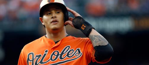 Should the Cubs trade Addison Russell for Manny Machado? [Image via nbcsports.com/YouTube]