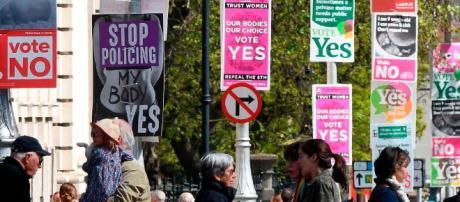 https://cdn.cnn.com/cnnnext/dam/assets/180524095236-01-ireland-abortion-referendum-signs-file-super-tease.jpg