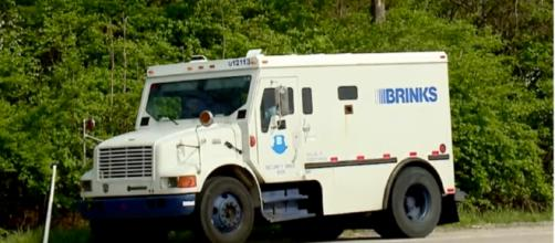 Brinks truck spills money and cops want you to give it back. Photo: NewZZCafe/YouTube screenshot