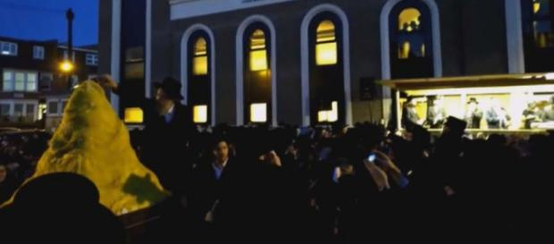 As the Lag Ba'Omer fire was lit during celebrations in northern London, an explosion injured 30 people. [Image YWN/YouTube]