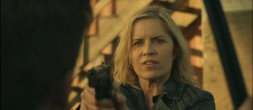 Madison pointing a gun at Mel. - [AMC / YouTube screenshot]