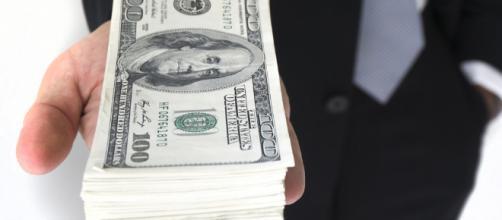 Money is magic. - [Image via Flickr / Creative Commons]