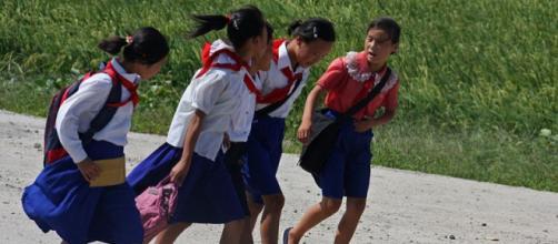 North Korean girls on the way to school. - [Image credit – Roman Harak / Wikimedia Commons]