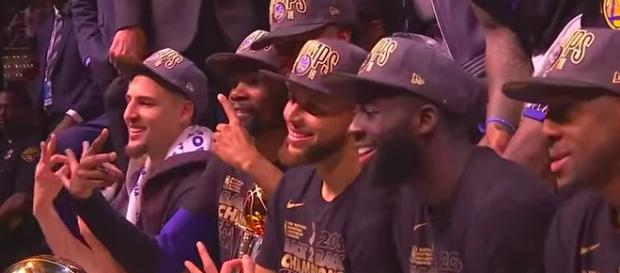 The Warriors core pose for a team picture after capturing their third NBA title in four years. - [CliveNBAParody / YouTube screenshot]