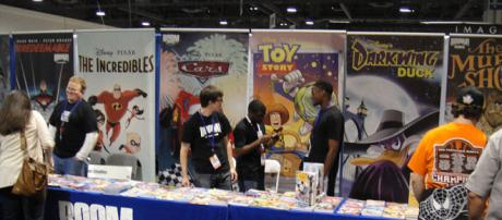 Boom! Studios comics booth (Image via: The Conmunity – Pop Culture Geek/Wikimedia Commons)