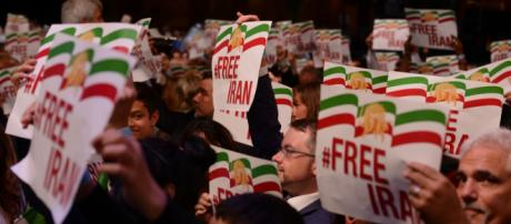 Iranians participating in 2017 Free Iran rally holding #Free Iran placards. Photo credit by The Media Express