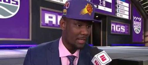 The Phoenix Suns' DeAndre Ayton leads the early odds to win next season's NBA Rookie of the Year award. - [Image via NBA / YouTube screencap]