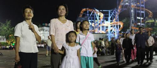 A family of North Korea at the Pyongyang Funfair (Image courtesy – Roman Harak, Wikimedia Commons)