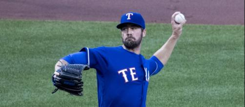 Cole Hamels pitching for the Rangers. - [Keith Allison / Wikimedia Commons]