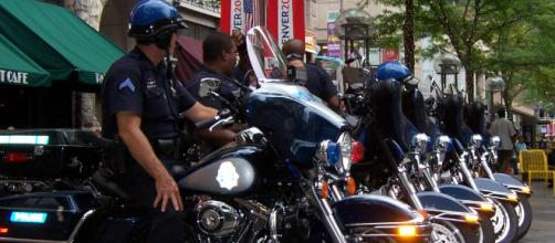 Denver police officers on motorcycles [Image source: Regroce - WikiMedia Commons]