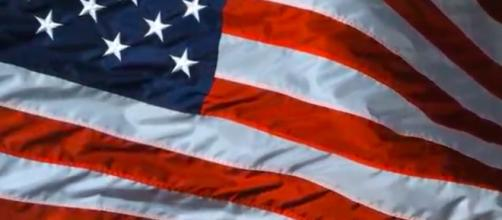 The American flag is often viewed as a symbol of freedom and opportunity. [Image source: FunnDevelopment/YouTube]
