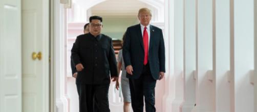 Kim and Trump walking to the summit room during the Singapore Summit. - [Dan Scavino Jr / Wikimedia Commons]