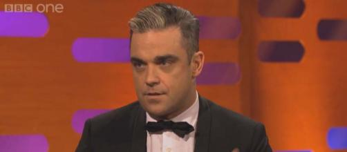 Robbie Williams believes he may have Asperger Syndrome or at least something on the autism spectrum. [Image BBC/YouTube]