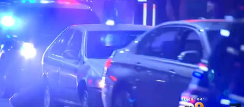 Cops engage in a bizarre slow speed chase through Los Angeles. [image source: CBS Los Angeles - YouTube]
