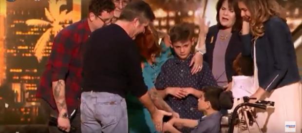 Adoptive dad, Michael Ketterer, celebrates his 'America's Got Talent' golden buzzer moment with Simon Cowell. -[AGT / YouTube screencap]