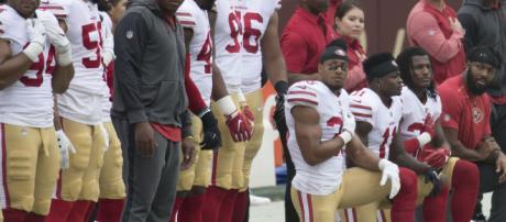 NFL kneeling [Image by Keith Allison / Wikimedia Commons]