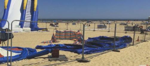 A young girl died after being thrown from an exploding bouncy castle at Gorleston Beach. [Image Norfolk Now/YouTube]