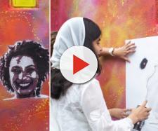 Malala participou de grafite em homenagem a Marielle Franco em comunidade do Rio de Janeiro. Foto: Reprodução.