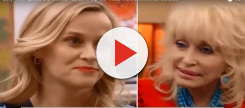 Reese Witherspoon and Dolly Parton share a few sequins and appreciation for Whitney Houston during interview. - [Joong Kim / YouTube screencap]