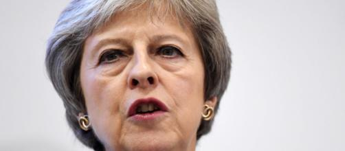 REINO UNIDO / Theresa May evita una derrota para su plan de Brexit