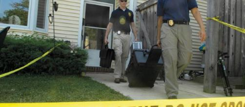 Detectives at a crime scene [Image source: Senior Airman Renae L. Kleckner - US Air Force]