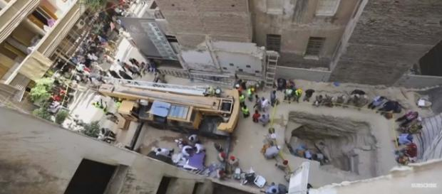 A massive black granite sarcophagus was discovered on a construction site in Alexandria. [Image Guardian News/YouTube]