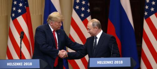 Trump shakes hands with Putin. - [Fox News / YouTube screencap]