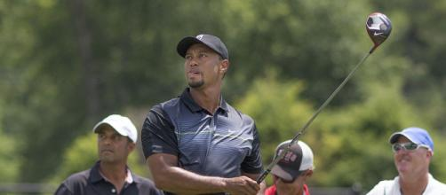 Tiger Woods practices on the driving range in Bethesda, Maryland (Image courtesy – Keith Allison, Wikimedia Commons)