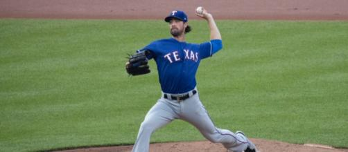 Cole Hamels was acquired by the Cubs on Thursday. [Image Source: Keith Allison - Flickr]