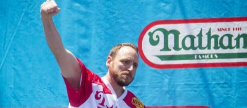 Joey Chestnut is once again the favorite at the Nathan's Hot Dog eating contest this year. [Image credit - The Guardian/YouTube]