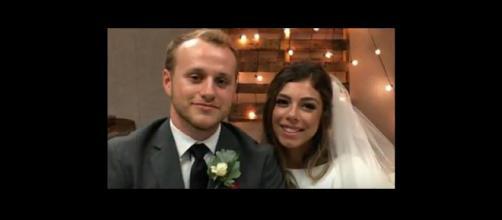 Josiah Duggar photographed with his bride, Lauren Swanson. [Image Source: Offline Daily - YouTube]
